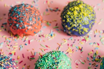 Brightly colored truffles or cake balls with sprinkles for post 12 Kid Friendly Gluten Free Valentine's Day Recipes
