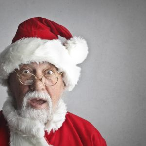 Surprised Santa for post how to navigate the santa struggle and family traditions
