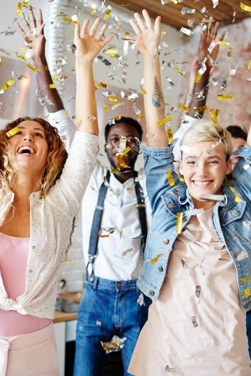People celebrating and throwing confetti for post How To Make Wise Choices and Live Without Regrets This Year