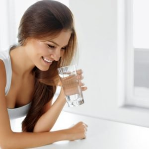 woman drinking water for post 3 ways to invest in your health in 2020