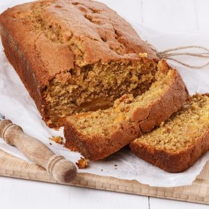 Pumpkin bread on a cutting board for post 5 delicious pumpkins bread recipes to try this fall