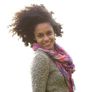 woman smiling for post 31 powerful identity in Christ verses in the Bible